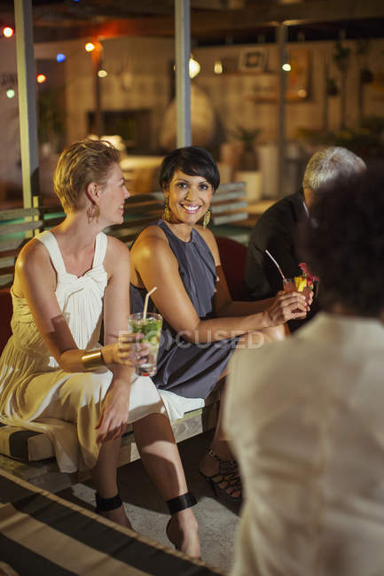 Women relaxing at party — Stock Photo
