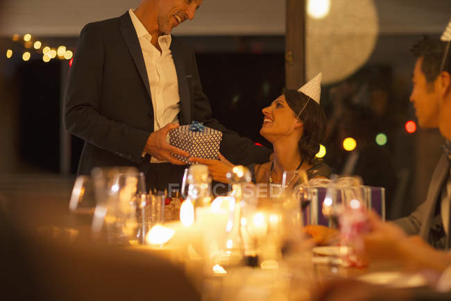 Man giving wife gift at birthday party — Stock Photo