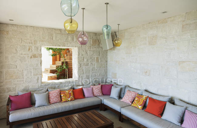 Cushions on patio bench indoors — Stock Photo