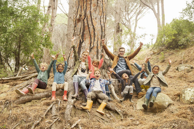 Students and teachers cheering in forest — Stock Photo