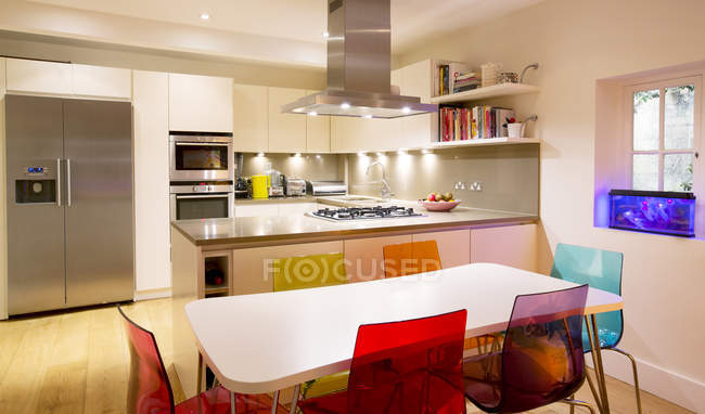 Modern kitchen and dining table — Stock Photo