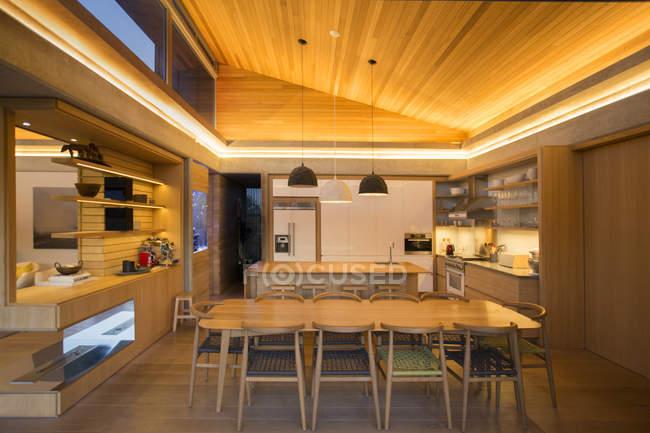 Illuminated home showcase kitchen — Stock Photo