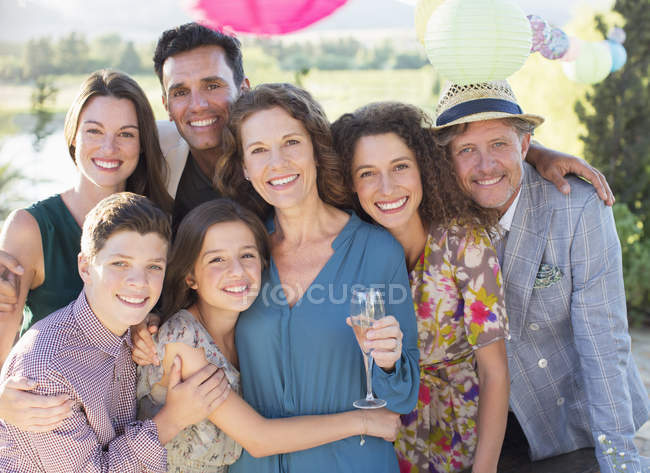 Happy beautiful family hugging outdoors — Stock Photo