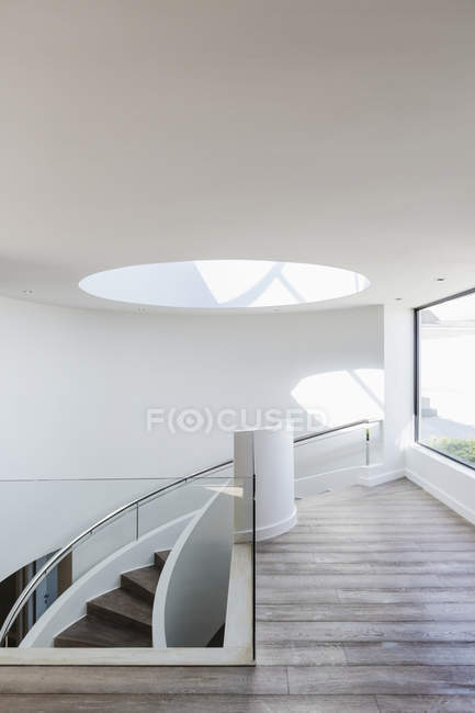 Round skylight at top of stairs in modern luxury home showcase interior — Stock Photo