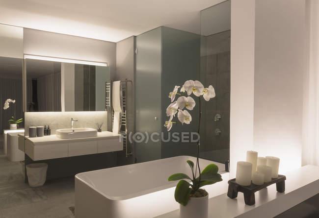 Illuminated modern, luxury home showcase bathroom — Stock Photo