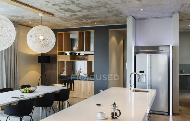 Luxury interior of modern house, dining room and kitchen — Stock Photo