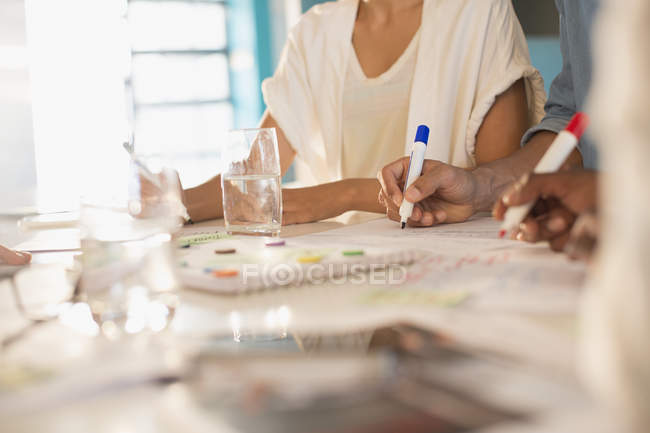 Creative business people brainstorming, writing — Stock Photo