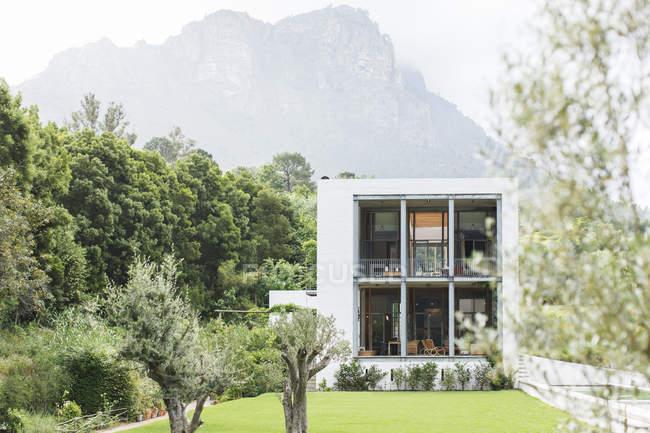Modern house in rural landscape — Stock Photo