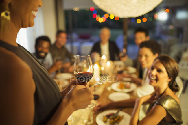 Woman proposing a toast at party — Stock Photo
