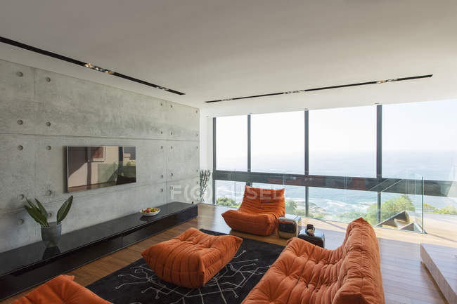 Sofas and ottoman in modern living room — Stock Photo