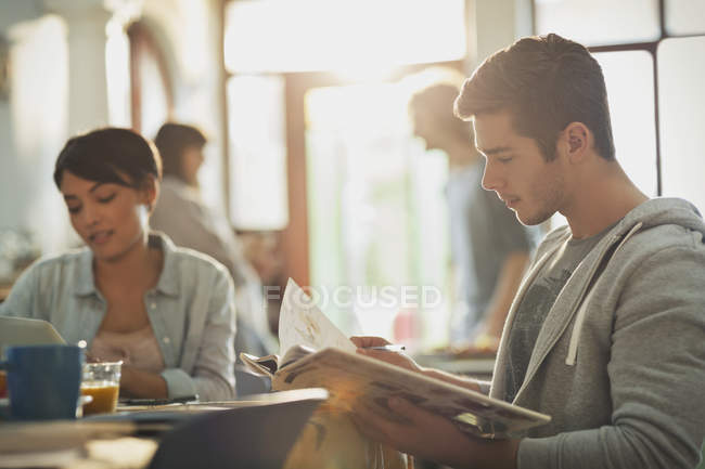 Young man college student reading book studying — Stock Photo