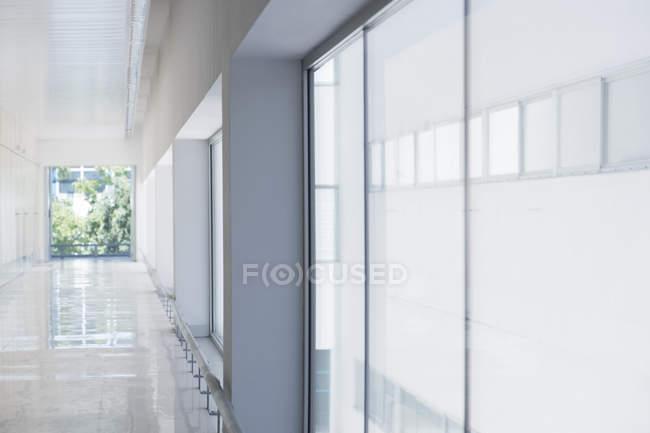 Empty Long office corridor in building — Stock Photo