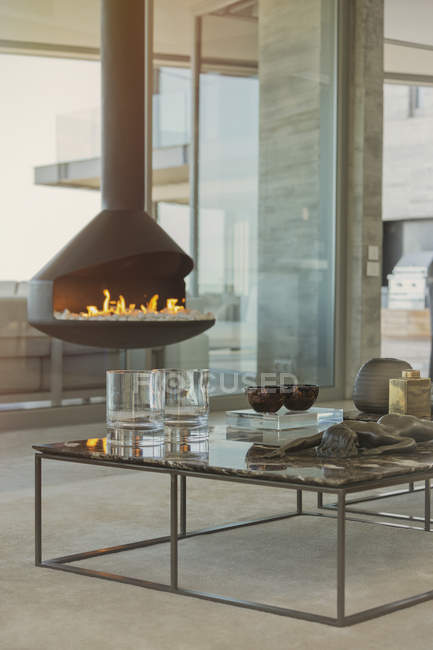 Modern fireplace hanging in luxury home showcase living room — Stock Photo