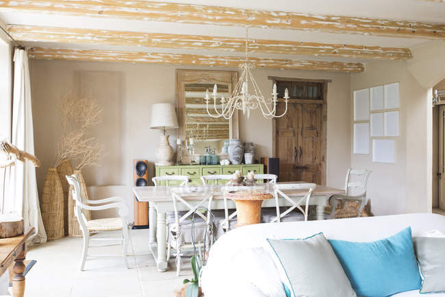 Living and dining area in rustic house — Stock Photo