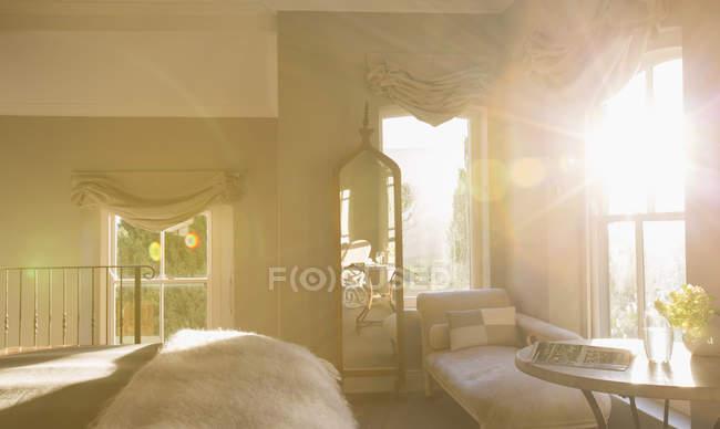 Sun shining in luxury bedroom — Stock Photo