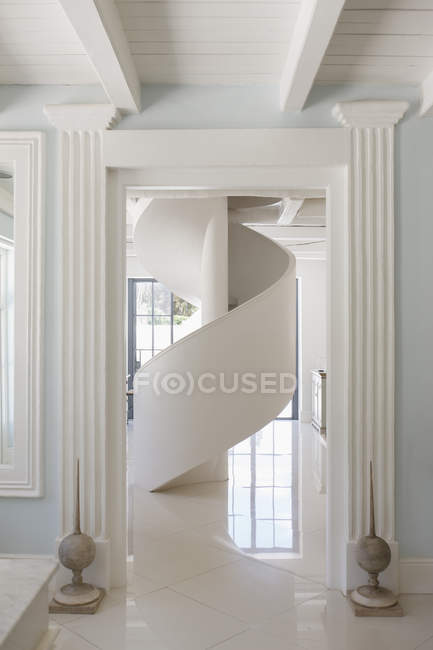 Spiral staircase in luxury foyer — Stock Photo