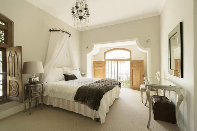 Elegant bedroom  indoors during daytime — Stock Photo