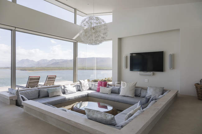 Modern luxury home showcase interior living room with ocean view — Stock Photo