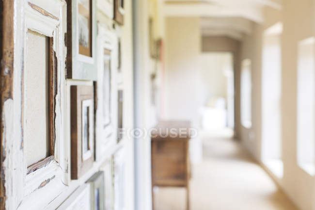 Decorative wall frames in rustic hallway — Stock Photo