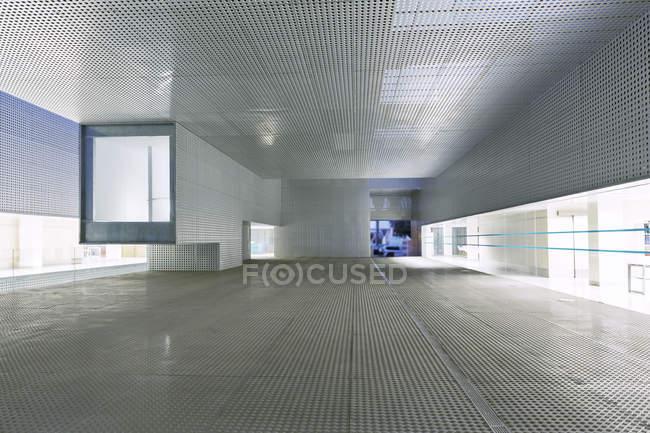 Illuminated windows of modern office building — Stock Photo