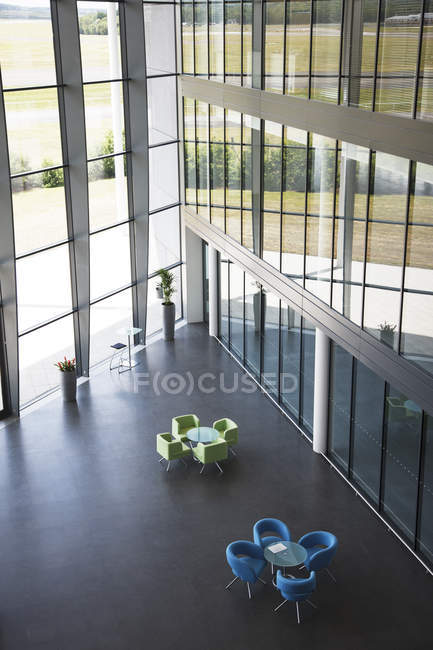 Chairs and table in office lobby area — Stock Photo