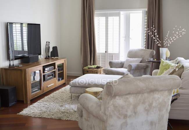 Television and armchairs in living room — Stock Photo