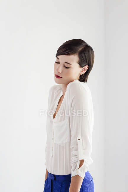 Serious woman shrugging and looking down — Stock Photo