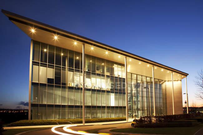 Modern building illuminated at night — Stock Photo