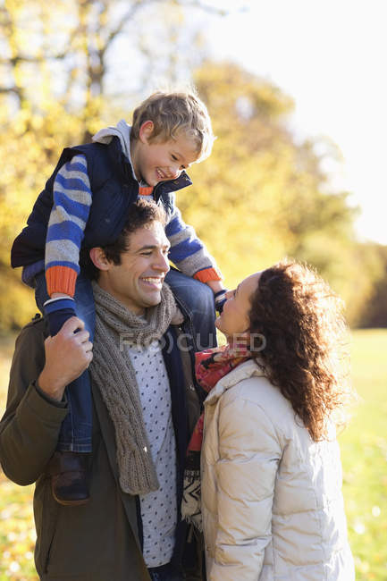 Happy family smiling together in park — Stock Photo