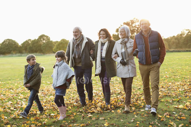 Caucasian family walking together in park — Stock Photo