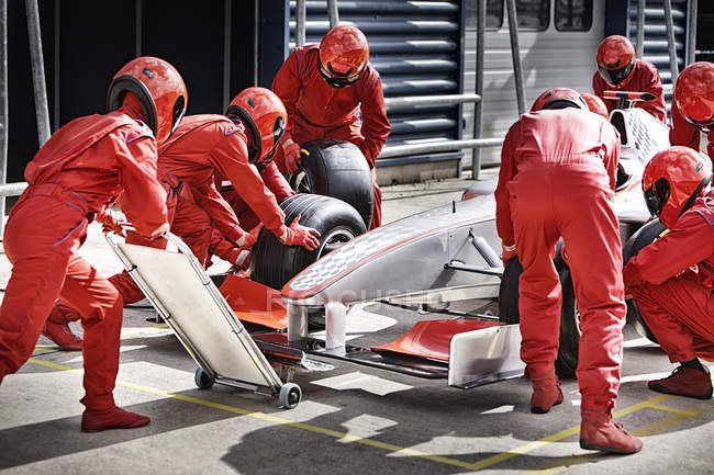 Racing team working at pit stop — Stock Photo