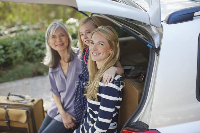 Three generations of women sitting in car — Stock Photo