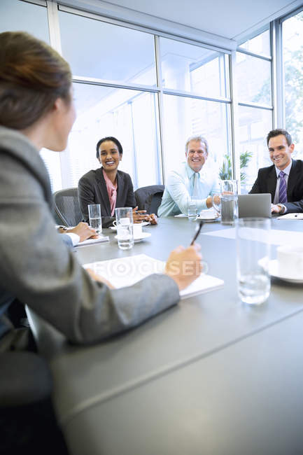 Smiling business people meeting in conference room at modern office — Stock Photo