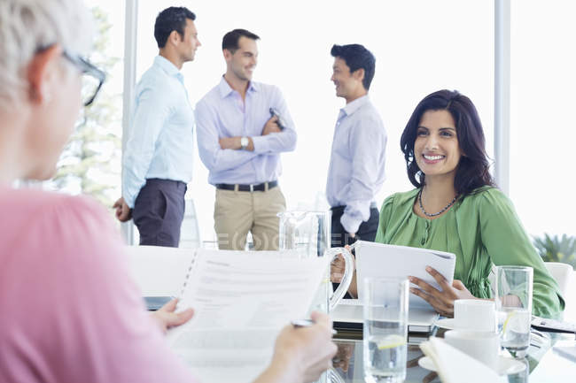 Business women talking in meeting at modern office — Stock Photo