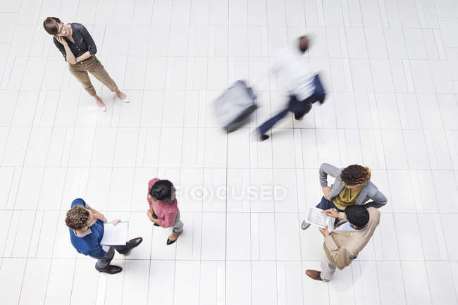 Business people in busy hallway at modern office — Stock Photo