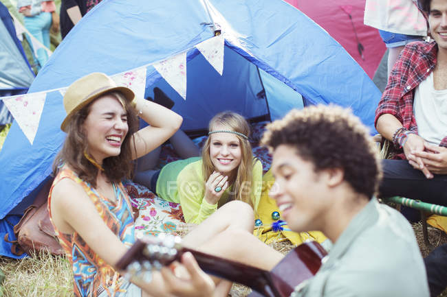 Friends hanging out at tent at music festival — Stock Photo