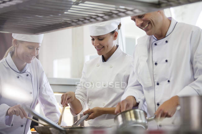 Chefs cooking in restaurant kitchen — Stock Photo
