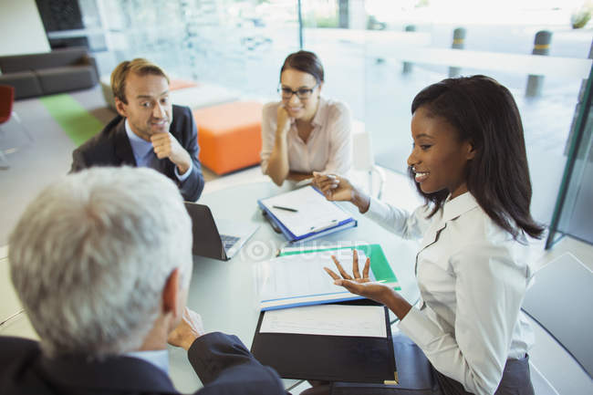 Business people talking at table in office building — Stock Photo