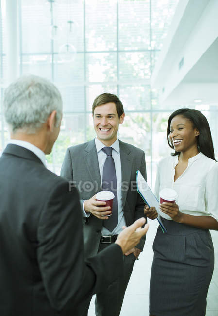 Business people talking in modern office building — Stock Photo