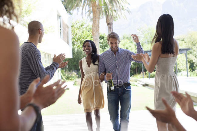 Young attractive Friends cheering for couple — Stock Photo