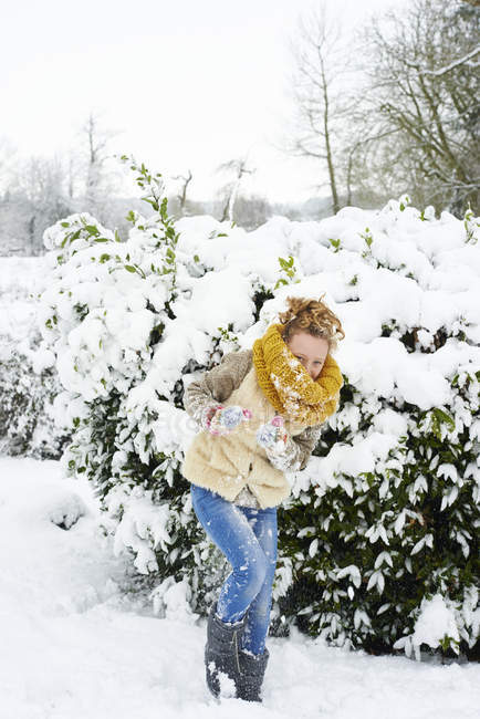 Caucasian happy girl playing in snow — Stock Photo