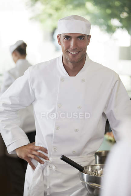 Chef smiling in restaurant kitchen — Stock Photo
