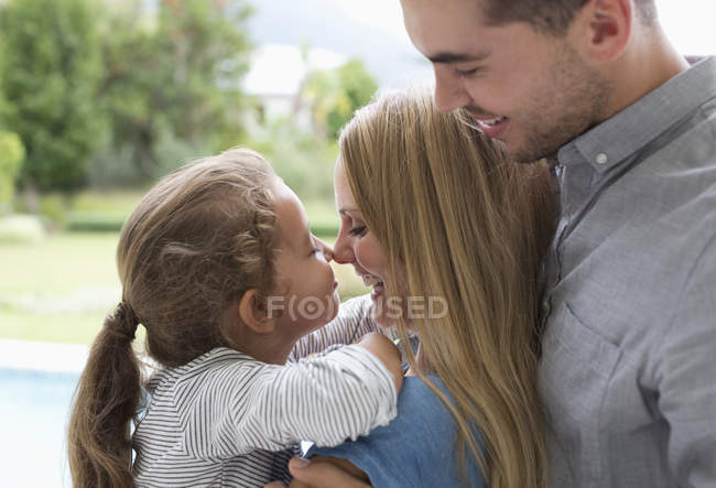 Mother and daughter touching noses outdoors — Stock Photo