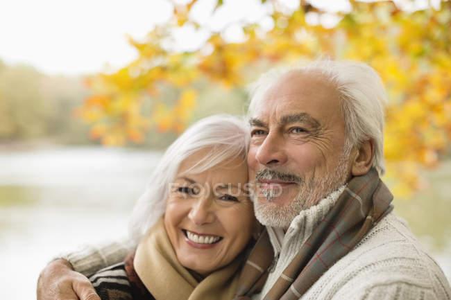 Caucasian older couple hugging in park — Stock Photo
