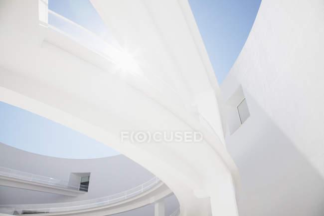 Sun shining behind elevated walkway — Stock Photo