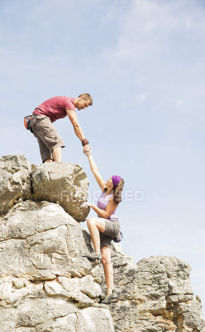 Side view of climbers scaling steep rock face — Stock Photo