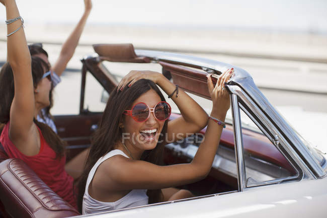 Smiling women driving convertible — Stock Photo