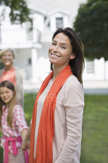 Three generations of women smiling outdoors — Stock Photo