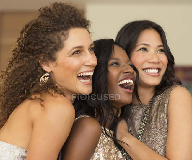 Young attractive Women smiling together at party — Stock Photo