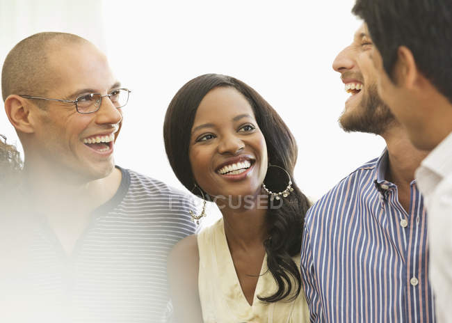 Young attractive Friends laughing together indoors — Stock Photo